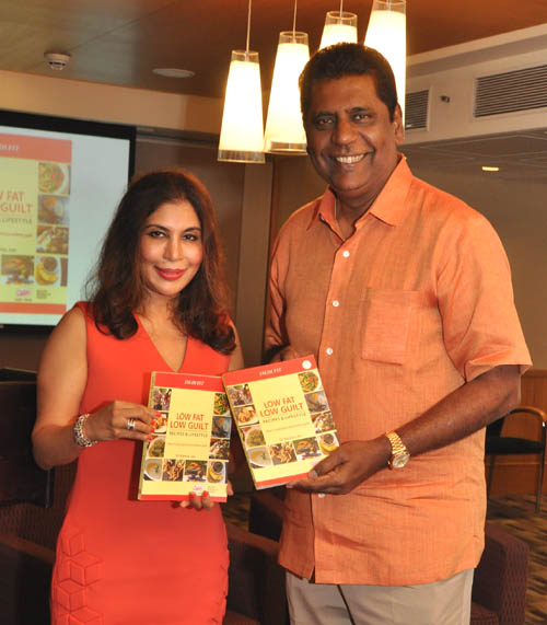 Namita Jain & Vijay Amritraj with the book